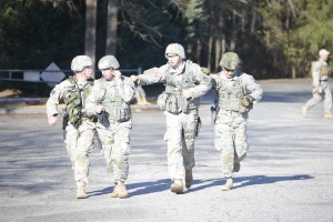The 416th TEC Team of (from left) Cpt. Freeman, Sgt. Halley, Staff Sgt. Raskie, and Sgt. Mercer complete a team run during a match at All Army at Fort Benning. The team won a number of awards for the TEC.