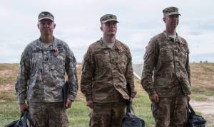 From left, 2015 FORSCOM Marksmanship Competition winners Capt. Dustin Duncan (M249),  Capt. Kirk Freeman (M4), and Master Sgt. Russell Moore (M9.) Freeman and Moore are members of the USARCMP. Not pictured is Sgt. Ben Mercer of the USARCMP who finished second overall in the M249 event.
