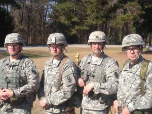 The 330th Infantry Regiment, 95th Division Team. From left, SSG Jonathan Duthler, SSG Richard Willis, LTC David F. Schultz, and CSM Steven J. Slee at the All Army Small Arms Competition, Fort Benning, February 1-9.